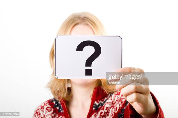 Woman holding white card with bold black question mark