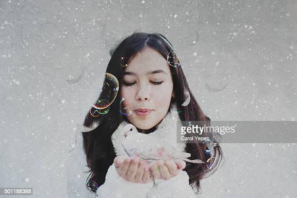 woman holding white dove bird