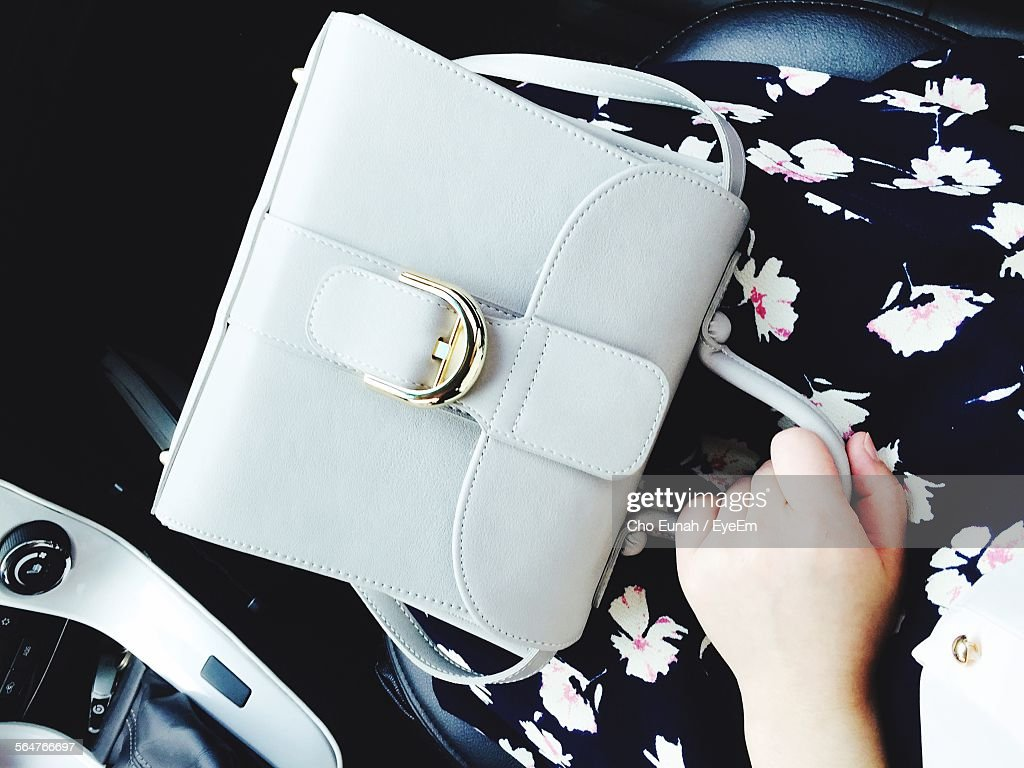 Woman Holding White Purse