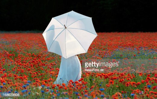 Woman Holding White Umbrella Standing in Large Poppy Field