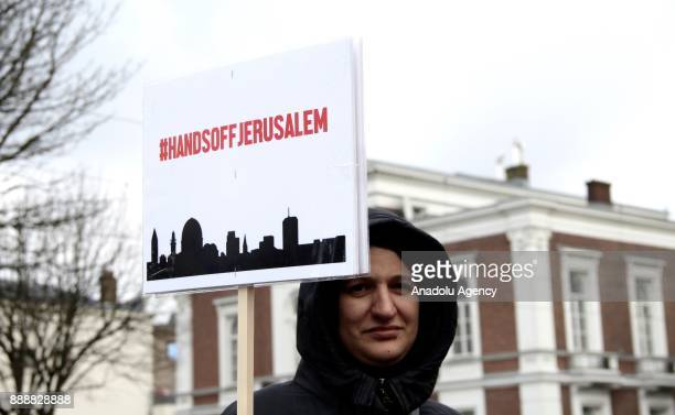 A woman holds a banner during a protest against US President Donald Trump's announcement to recognize Jerusalem as the capital of Israel and plans to...