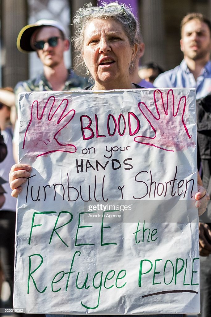 A woman holds a banner during a protest demanding that asylum seekers held in off shore detention to be brought to Australia at a rally in Melbourne, Australia on April 30, 2016. Protests have started after The Papua New Guinean Supreme Court ruled that the Australian-run detention centres on Manus Island were illegal and unconstitutional.