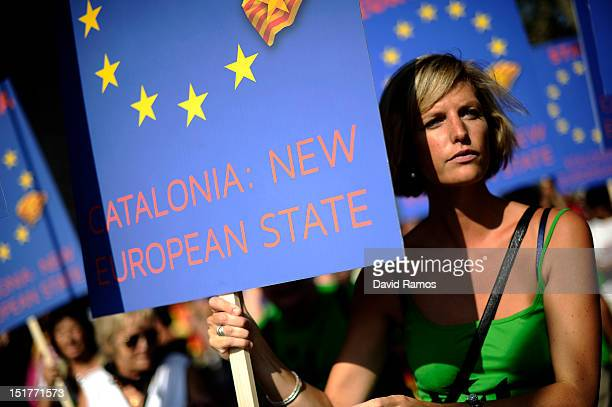 A woman holds a banner that it reads 'Catalonia New European State' during a demonstratacion calling for independence during the Catalonia's National...