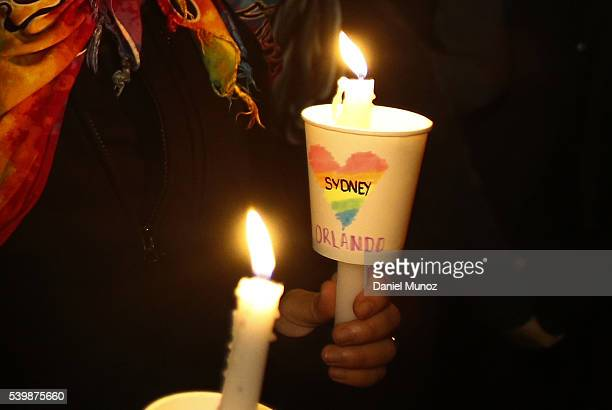 A woman holds a candle during a candlelight vigil for the victims of the Pulse Nightclub shooting in Orlando Florida at Newtown Neighbourhood Centre...