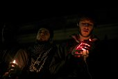 A woman holds a candle during a vigil at the University of North Carolina following the murders of three Muslim students on February 11 2015 in...