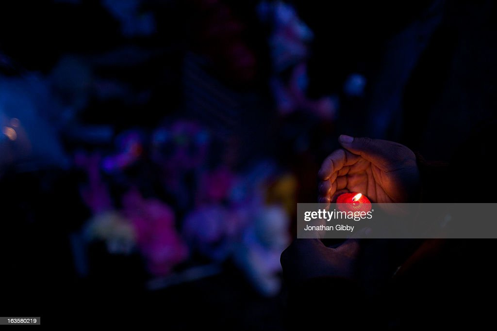 A woman holds a candle during a vigil for slain infant Jonylah Watkins on March 12, 2013 in Chicago, Illinois. The 6-month-old girl was shot five times on the 6500 block of South Maryland Avenue while her father was changing her diaper in the passenger seat of his car. The father, Jonathan Watkins remains is stable condition at Nothwestern Memorial Hospital after receiving three gunshot wounds.
