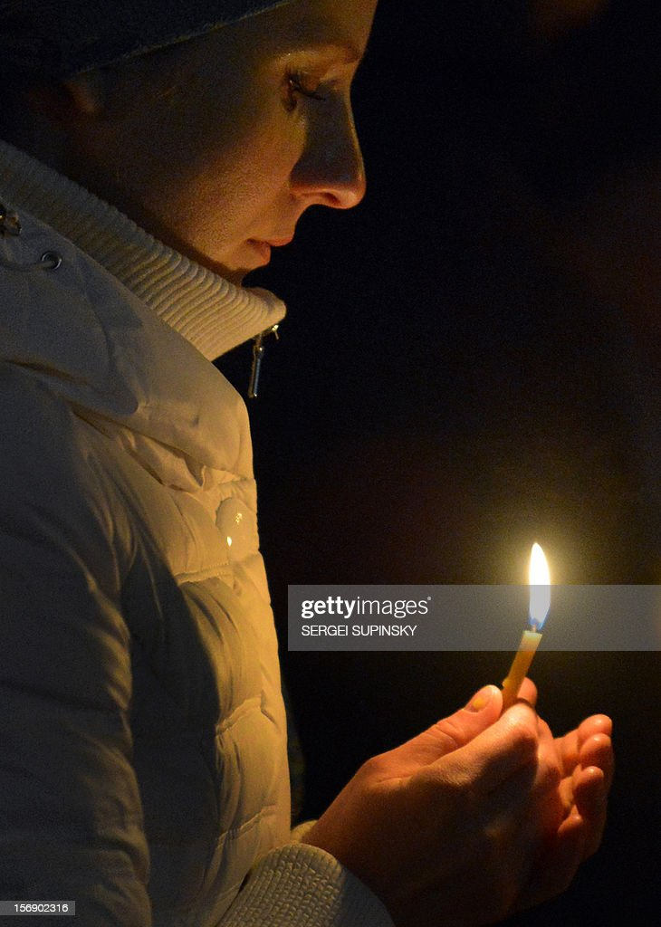 A woman holds a candle in memory of the victims of the Holodomor famine in Kiev on November 24, 2012. Ukraine marked 80 years since the Stalin-era Holodomor famine, one of the darkest pages in its entire history that left millions dead and which is regarded by many as a genocide. The 1932-33 famine took place as harvests dwindled and Josef Stalin's Soviet police enforced the brutal policy of collectivising agriculture by requisitioning grain and other foodstuffs.