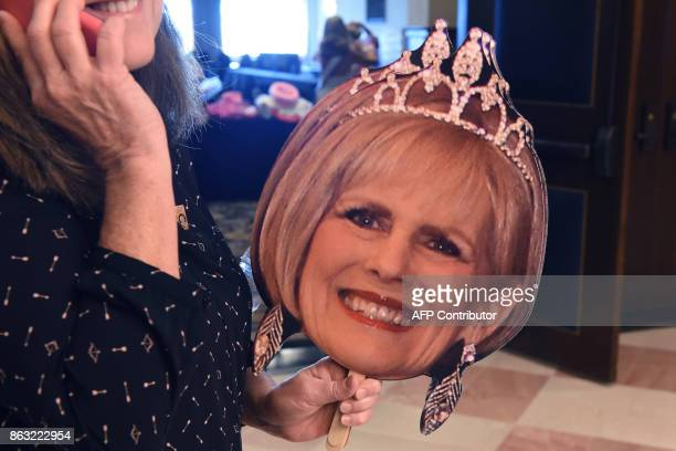 A woman holds a cardboard cutout of Ms Arizona Leta Sproule before the finals of the 38th Annual National Ms Senior America 2017 Pageant held at the...