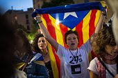 A woman holds a Catalan ProIndependence flag up as she signs the Cataland anthem on September 27 2015 in Barcelona Spain The main Catalanist parties...