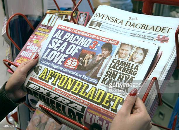 A woman holds a copy of Aftonbladet at a local newsagent in Stockholm Sweden on Friday Nov 2 2007 A copy of Svenska Dagbladet sits on a newsstand in...