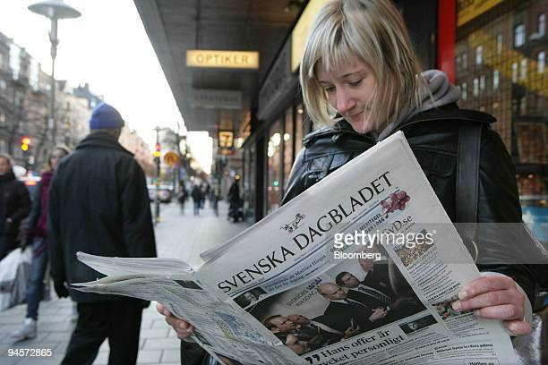 A woman holds a copy of Svenska Dagbladet outside of a local newsagent in Stockholm Sweden on Friday Nov 2 2007 Schibsted ASA Norway's biggest media...