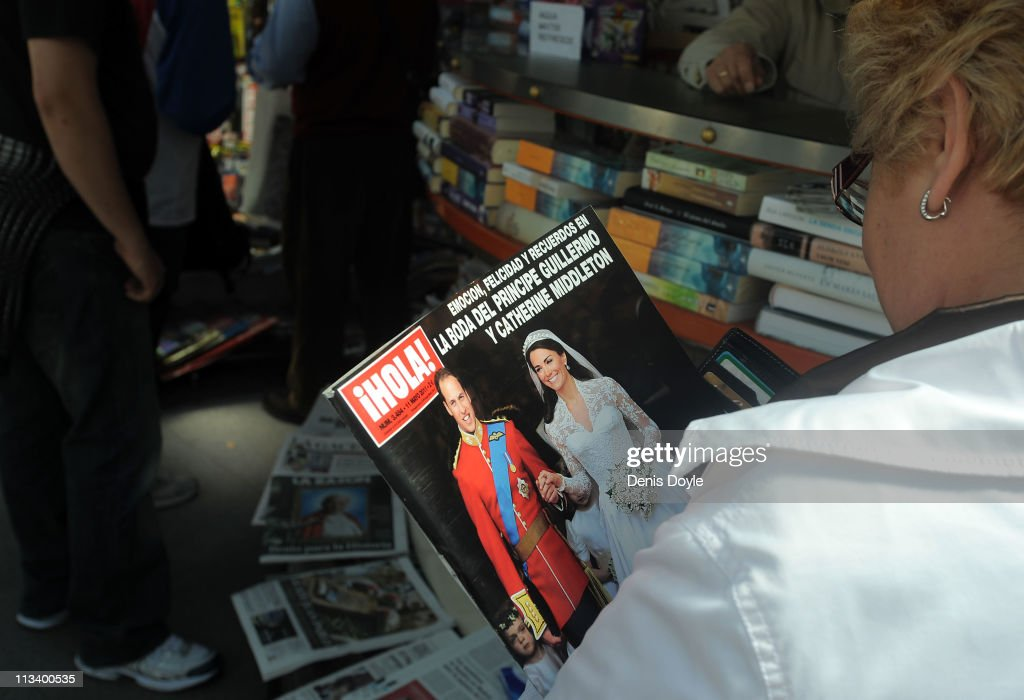 A woman holds a copy of the Spanish magazine Hola showing an image of the marriage of their Royal Highnesses Prince William, Duke of Cambridge and Catherine, Duchess of Cambridge following their wedding the day before, at a newsstand on May 2, 2011 in Madrid, Spain.