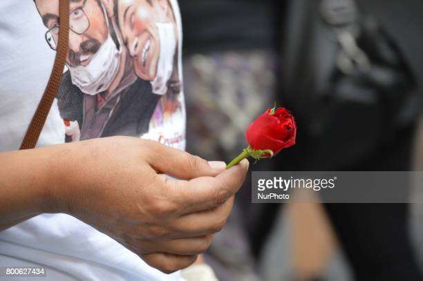 A woman holds a flower during a march in support of sacked academic Nuriye Gulmen and primary school teacher Semih Ozakca in Ankara Turkey on June 24...
