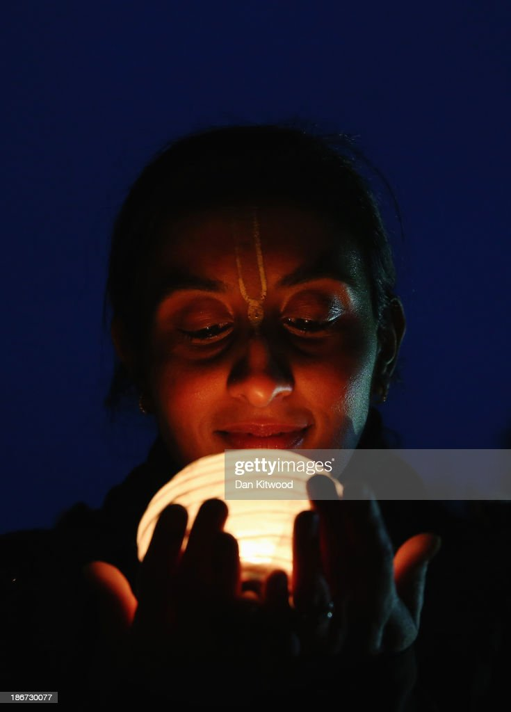 A woman holds a lantern during Diwali celebrations at Bhaktivedanta Manor on November 3, 2013 in Watford, United Kingdom. The festival is an opportunity for Hindus to honour Lakshmi, the goddess of wealth and other gods. Leicester's celebrations are one of the biggest in the world outside India.