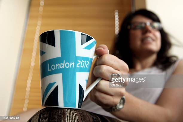 A woman holds a London 2012 branded mug at the launch of the London Olympic Games official merchandise on July 30 2010 in London England The...