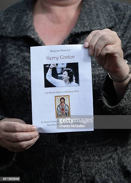 A woman holds a mass service card at the funeral of Gerry Conlon at St Peter's Cathedral for a requiem mass on June 28 2014 in Belfast Northern...