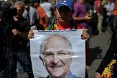 A woman holds a pictures of Ledezma during a rally for the liberation of the Mayor in Caracas Venezuela on February 20 2015 Metropolitan Mayor of...