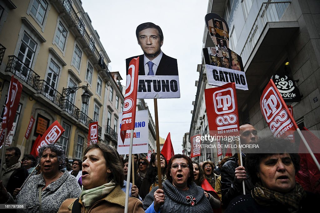 A woman holds a placard depecting a picture of Portuguese Prime Minister Pedro Passos Coelho and reading 'Thief' during a demonstration organized by Portugal's biggest trade union CGTP (Portuguese General Workers Confederation) against government austerity measures in Lisbon, on February 16, 2013.