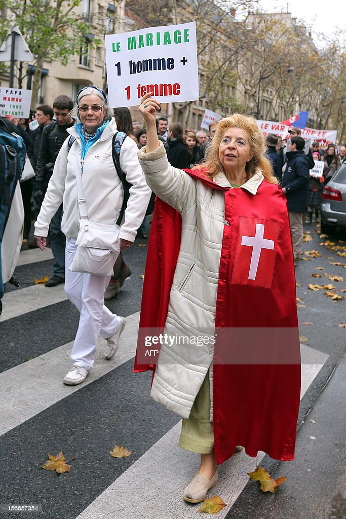A woman holds a placard during a protest organized by fundamentalist Christians group Civitas Institute against the same-sex marriage on November 18, 2012 in Paris. France's Socialist government on November 7, 2012 adopted a draft law to authorise gay marriage and adoption despite fierce opposition from the Roman Catholic Church and the right-wing opposition.
