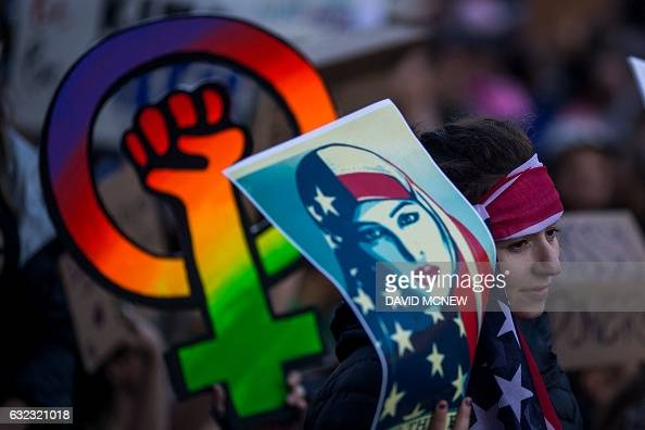 TOPSHOT A woman holds a placard during the WomenÕs March on the day after the inauguration of President Trump on January 21 2017 in Los...