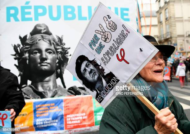 TOPSHOT A woman holds a placard reading 'for the 6th Republic' during the 'Marche pour la VI Republique' called by the farleft coalition 'La France...