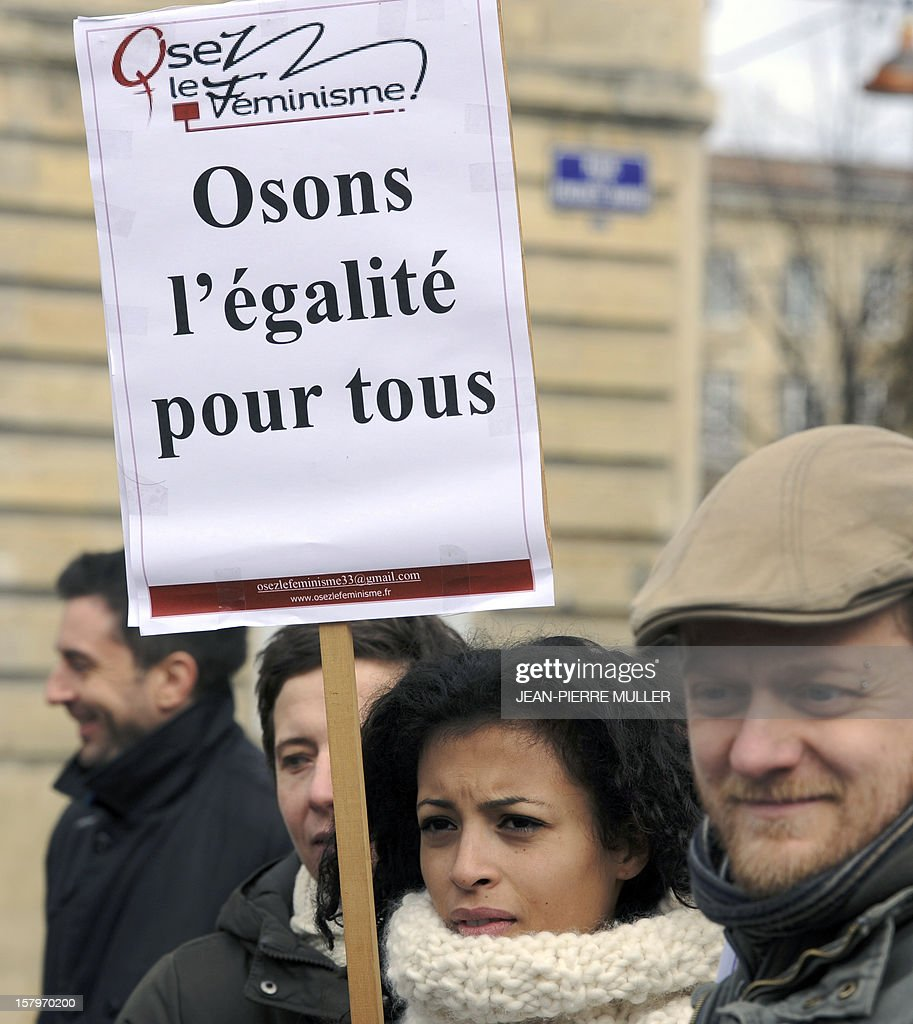 A woman holds a placard reading 'Let's dare equality for everyone' during a demonstration to support same sex marriages in Bordeaux, south eastern France on December 8, 2012.