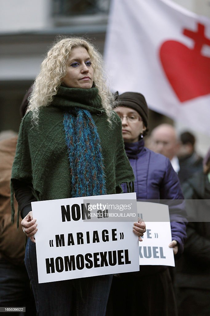 A woman holds a placard reading 'no to same-sex marriage' during a protest organized by fundamentalist Christians group Civitas Institute against same-sex marriage on April 4, 2013 in front of the French Senate in Paris on the first day of the debate at France's upper house on the controversial bill to legalise same-sex marriage and adoption. While the upper house is unlikely to reject the groundbreaking reform, it is still expected to be a tight vote as the ruling Socialists enjoy a smaller majority in the Senate than in the National Assembly. AFP PHOTO / KENZO TRIBOUILLARD