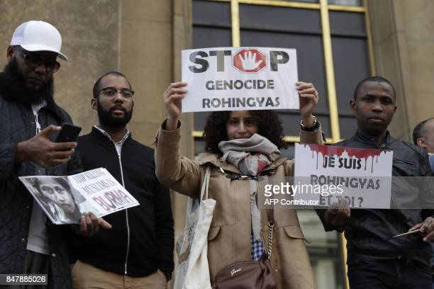A woman holds a placard reading 'stop to the massacre of Rohingya' as she takes part in a rally in Paris on September 16 to protest the situation of...