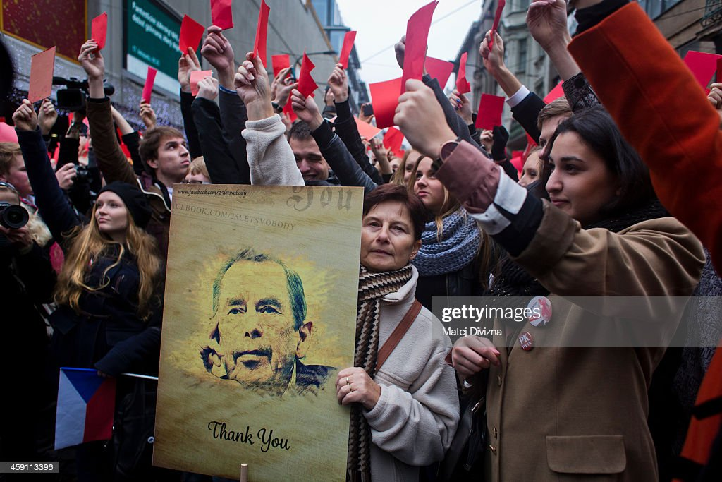 A woman holds a placard with a picture of former President of Czechoslovakia and Czech Republic Vaclav Havel as people show red card as they protest against President of Czech Republic <a gi-track='captionPersonalityLinkClicked' href=/galleries/search?phrase=Milos+Zeman&family=editorial&specificpeople=2595776 ng-click='$event.stopPropagation()'>Milos Zeman</a> near a memorial to students who were attacked by riot police in 1989 on the 25th anniversary of the Velvet Revolution on November 17, 2014 in Prague, Czech Republic. Prague is commemorating the anniversary with a variety of events, including the unveiling of a plaque by the presidents of the Czech Republic, Germany, Hungary, Poland and Slovakia. In November, 1989, hundreds of thousands of people took to the streets of Prague and other cities across what was then still communist Czechoslovakia to demand political reforms and greater freedoms. The communist leadership soon crumbled and the playwright and human rights activist Vaclav Havel became president shortly thereafter.