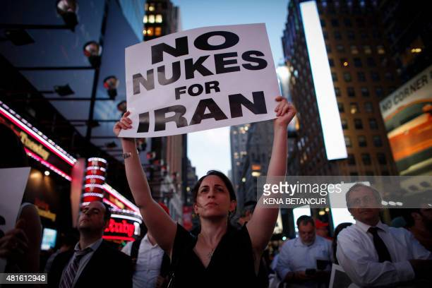 A woman holds a poster as she takes part in a rally July 22 2015 on Times Square in New York opposing the nuclear deal with Iran AFP PHOTO / KENA...