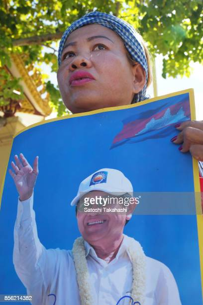 A woman holds a poster of Cambodia's main opposition Cambodia National Rescue Party President Kem Sokha calling for his release Kem Sokha was...