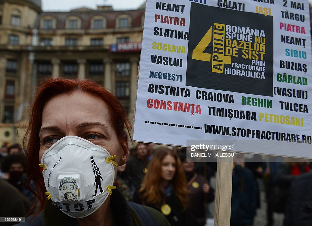 A woman holds a poster reading 'Romania say no to the shale gas exploiting by fracking' during a demonstration against hydraulic fracturing (fracking) in Bucharest April 4, 2013. Around 300 protesters gathered in Bucharest's University Square in protest against the drilling technique, which uses high pressure injections of water, sand and chemicals to crack open rock and release oil and gas trapped inside. Hundreds of Romanians rallied in several cities to protest against shale gas drilling, voicing concerns over environmental pollution and health hazards.The protesters called on the centre-left government to revoke permits granted to several oil groups, including US giant Chevron, enabling them to start exploration drilling. 'Chevron, go home,' and 'Down with traitors', they chanted, in reference to Prime Minister Victor Ponta who earlier this year said he was favorable to shale gas drilling after repeatedly declaring he was against, while he was in opposition.Nearly 1,000 people rallied in Barlad, an eastern Romanian city lying close to a 600,000 hectare concession granted to Chevron.Several hundred persons also staged a protest in Buzias, a resort famous for its mineral water lying in a western Romanian region where a Luxembourg-based company plans to start drilling. A U.S. Energy Information Administration study said the joint reserves for Romania, Bulgaria and Hungary were around 538 billion cubic metres, among the biggest in eastern Europe. AFP PHOTO DANIEL MIHAILESCU