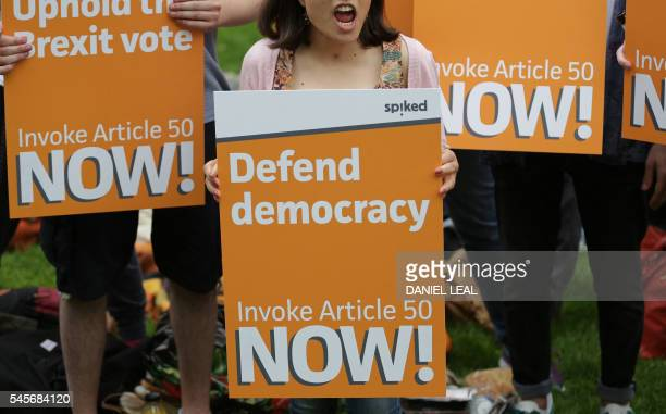 A woman holds a proBrexit placard as a group of people set up a counter demonstration to a group taking part in a picnic against Brexit organised by...