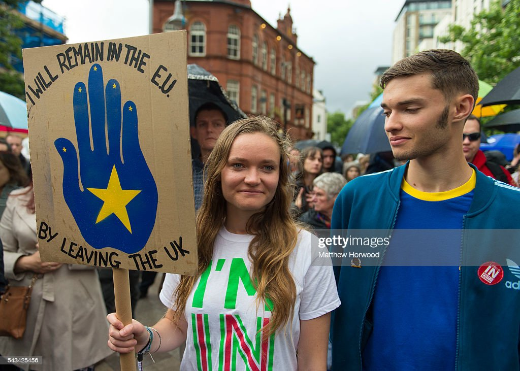 A woman holds a pro-EU sign during an anti-Brexit rally on June 28, 2016 on the Hayes in Cardiff, Wales. The protest is at a time of economic and political uncertainty following the referendum result last week, which saw the UK vote to leave the European Union.