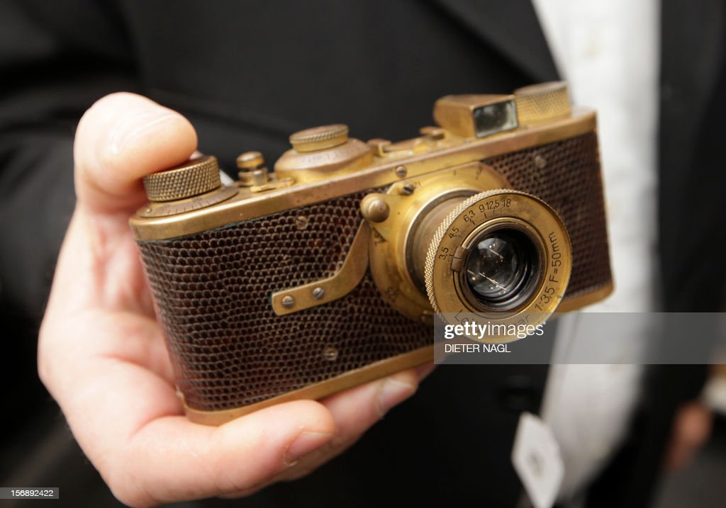 A woman holds a rare Leica I(A) Luxus gold plated camera dated 1929 during an auction of antique cameras on November 24, 2012 in Vienna. The camera is sold for 850.000 Euro, only 95 of this Leica models were produced between 1929 and 1931.