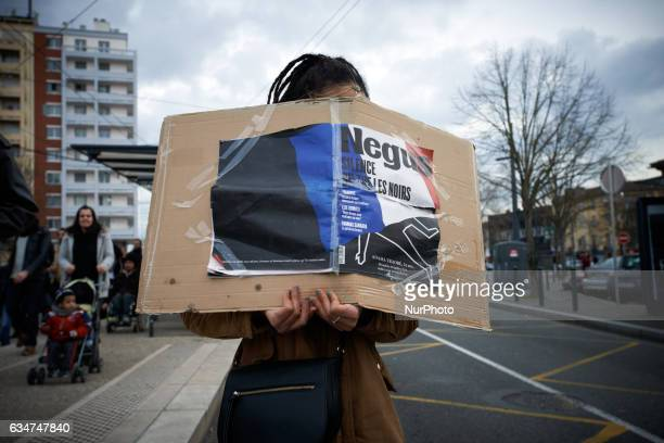 A woman holds a selfmade placrd reading 'Silence we kill blacks' A unauthorized march took place in Toulouse France on February 11th 2016 in protest...