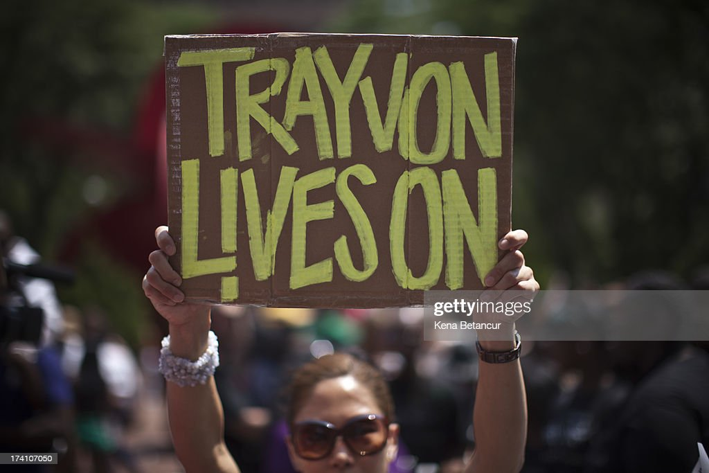 A woman holds a sign as she attends a rally honoring Trayvon Martin organized by the National Action Network outside One Police Plaza in Manhattan on July 20, 2013 in New York City. Demonstrators have gathered in various cities across the country to protest the acquittal of neighborhood watchman George Zimmerman and press for his federal prosecution in the shooting death of teenager Trayvon Martin.