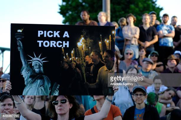 A woman holds a sign at a rally in Portland Ore United States on August 18 to show solidarity against hate with Charlottesville Va one week after...