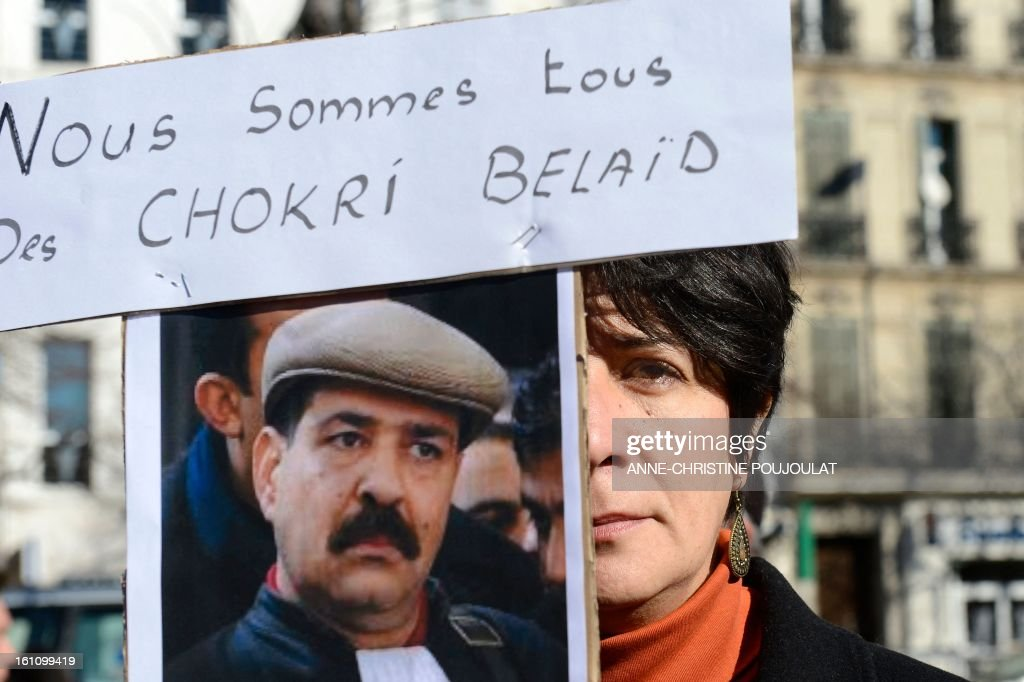 A woman holds a sign bearng a picture of murdered opposition figure Chokri Belaid and reading 'We are all some Chokri Belaid' during a protest to pay tribute to Belaid on February 9, 2013, in Marseille, southern France. The shooting of Belaid, a leftist leader and outspoken government critic by a lone, hooded gunman on February 6, 2013 plunged Tunisia into new post-revolt turmoil as tension and division within the Ennahda party itself intensified. AFP PHOTO / ANNE-CHRISTINE POUJOULAT