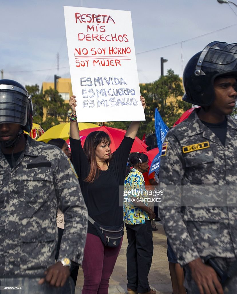 A woman holds a sign during a proabortion demonstration in front of the National Congress in Santo Domingo Dominican Republic on December 16 2014 The...