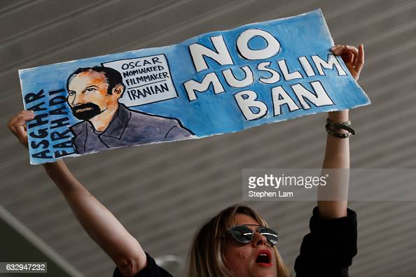 A woman holds a sign during a rally against a ban on Muslim immigration at San Francisco International Airport on January 28 2017 in San Francisco...