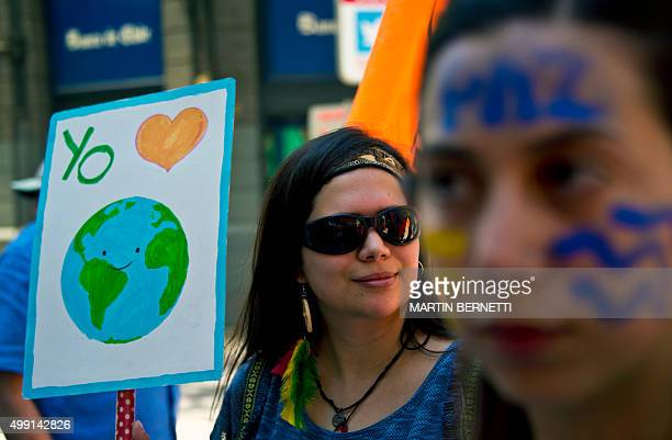 A woman holds a sign during the Global Climate March in Santiago on November 29 on the eve of the UN conference on climate change COP 21 to take...