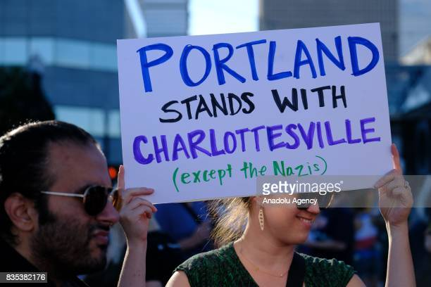 A woman holds a sign in Portland Ore United States on August 18 showing solidarity against hate with Charlottesville Va one week after white...