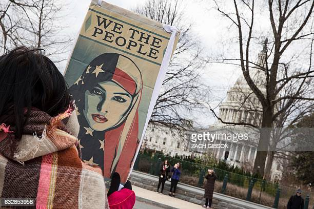 A woman holds a sign near The US Capitol building during the 44th annual March for Life on January 27 2017 in Washington DC Antiabortion activists...