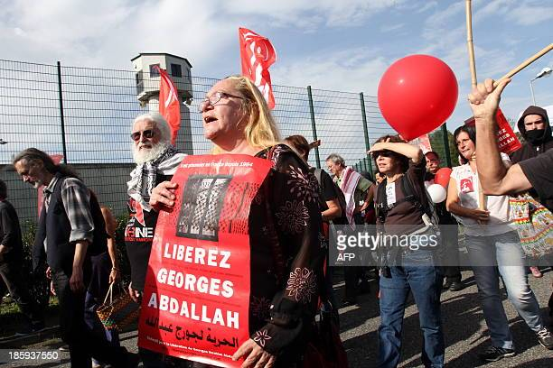 A woman holds a sign reading 'Liberate Georges Abdallah' as she takes part in a protest calling for the liberation of Lebanese activist Georges...