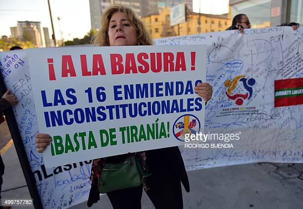 A woman holds a sign reading 'The 16 constitutional amendments to the garbage can Enough of tyranny' as she demonstrates against a constitutional...
