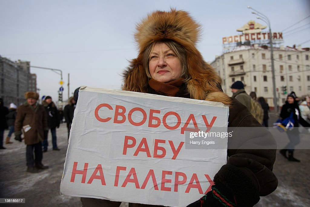 A woman holds a sign that reads 'Freedom to the galley slaves' during a protest in Bolotnaya Square on February 4, 2012 in Moscow, Russia. Demonstrators braved temperatures as low as -20 degrees celsius as they took to the streets exactly one month before the presidential elections in protest against Vladimir Putin's efforts to return to the Kremlin for an unprecedented third term as President.