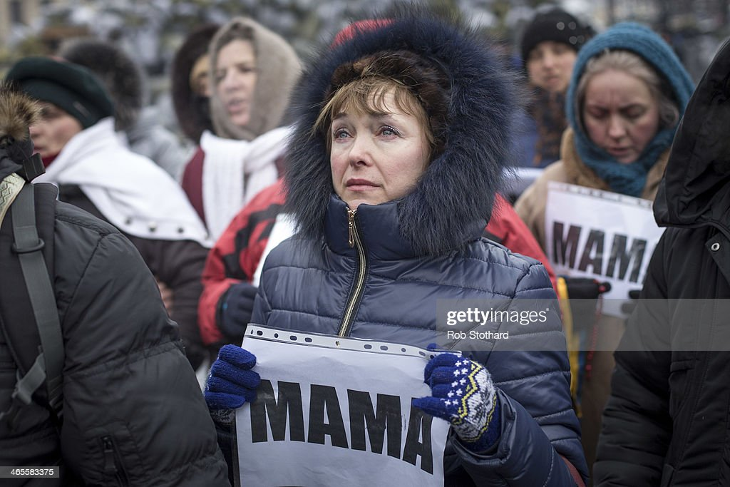 A woman holds a sign that reads 'mama' during a march led by Orhodox priests towards police lines, urging them not to harm protestors on Grushevskogo Street on January 28, 2014 in Kiev, Ukraine. Ukraine's parliament is holding a special session called over continuing unrest in the country and Prime Minister Mykola Azarov has offered to resign.