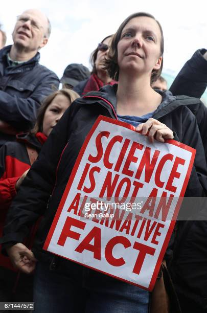 A woman holds a sign that reads 'Science is not an alternative fact' during the 'March for Science' demonstration on April 22 2017 in Berlin Germany...