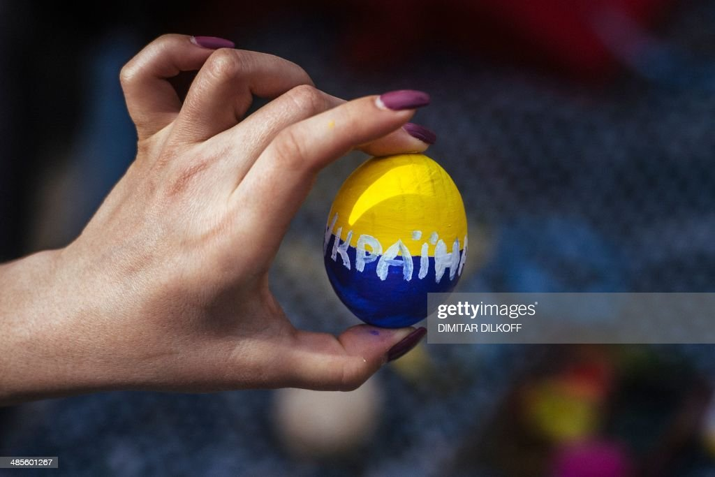 A woman holds a wooden Easter egg painted with the colors of the Ukrainian flag during a pro-Ukrainian rally in the eastern Ukrainian city of Lugansk, on April 19, 2014. Russia was under intense US pressure Saturday to convince pro-Moscow rebels in Ukraine to give up eastern towns they are occupying, after Washington said the situation in the former Soviet republic was in a 'pivotal period'.